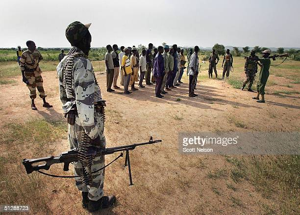 Rebel Sudanese Justice and Equality Movement fighters report for a roll call at their base in the Darfur region of Sudan on September 7 2004 in...