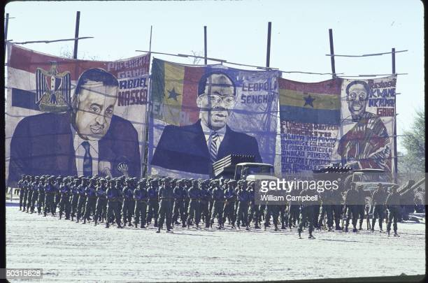 UNITA rebel troops parading in front of pictures of Egypt's Gamal Abdul Nasser and Ghana's Pres Kwame Nkrumah