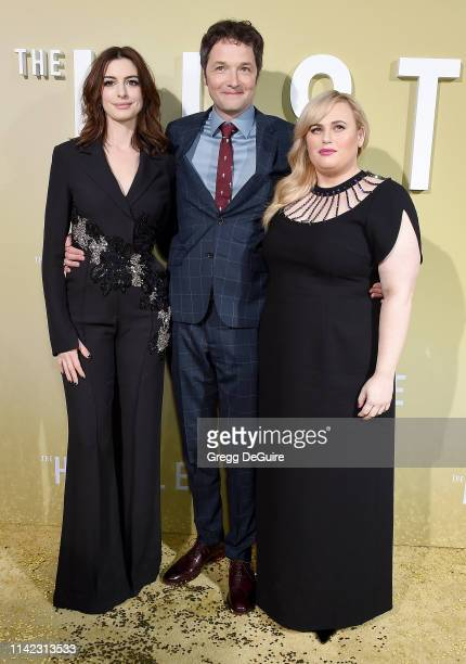 Rebel Wilson director Chris Addison and Anne Hathaway arrive at the Premiere Of MGM's The Hustle at ArcLight Cinerama Dome on May 8 2019 in Hollywood...
