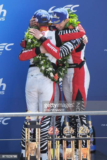 Rebellion R13 Gibson LM P1 drivers Thomas Laurent Switzerland's Mathias Beche and US Gustavo Menezes celebrate after placing third of the 86th...