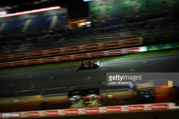 Rebellion R13 Gibson LM P1 German driver Andre Lotterer competes during the 86th Le Mans 24hours endurance race at the Circuit de la Sarthe at night...