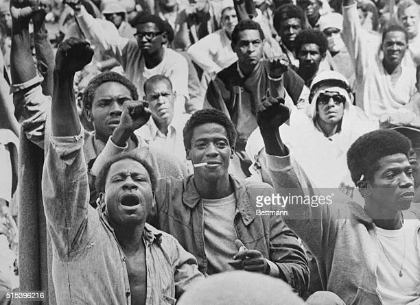Rebellious inmates at the Attica Correctional Facility give the black power salute while Commissioner RG Oswald negotiates with leaders of the...
