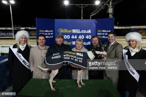 Rebellious Queen and supporters celebrate winning the Williamhillcom Angel of the North Oaks Final at the Brough Park Greyhound Stadium Newcastle