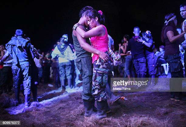 Rebels and supporters dance at a concert at the 10th Guerrilla Conference in the remote Yari plains where the peace accord was in the process of...