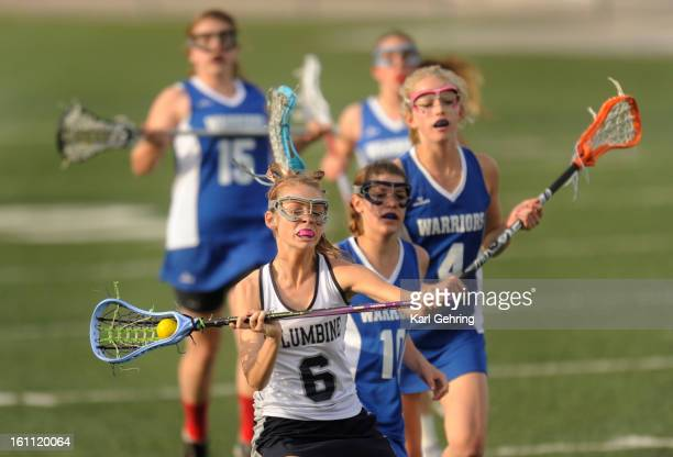 Rebels attacker Paige Amme takes a shot on goal in the first half. The Columbine High School girls lacrosse team defeated Centaurus 13-9 in a...