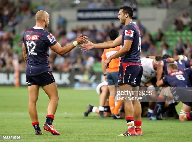 Rebels' Billy Meakes and Jack Debreczeni react during the Super Rugby union match between the Melbourne Rebels of Australia and the Coastal Sharks of...