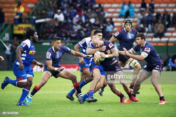 Rebels' Billy Meakes is tackled during the Super Rugby rugby union match between South Africa's Stormers and Australia's Rebels on April 27 at...
