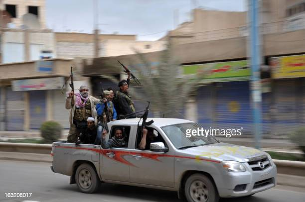 Rebels celebrate in a street in the northern Syrian city of Raqqa after capturing the city on March 4 2013 Syrian rebels battling troops loyal to...