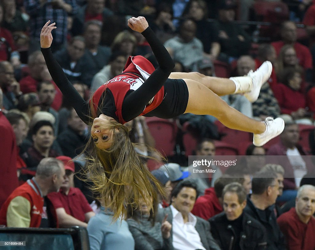 Rebels cheerleader flips in the air during the team's game against the Arizona State Sun Devils at the Thomas & Mack Center on December 16, 2015 in Las Vegas, Nevada. Arizona State won 66-56.
