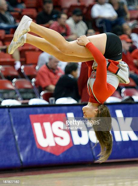 Rebels cheerleader flips through the air during the team's game against the UC Santa Barbara Gauchos at the Thomas Mack Center on November 12 2013 in...