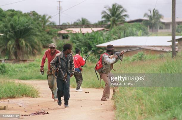 Rebels loyal to warlord Charles Taylor of the National Patriotic Front of Liberia patrol 11 July 1990 in Paynesville during the fighting with the...