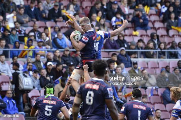 TOPSHOT Rebels' Matt Philip catches the ball in a line out during the Super Rugby rugby union match between South Africa's Stormers and Australia's...