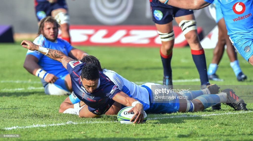 Rebels' Michael Ruru (L) scores a try as he is tackled by Bulls' Lood de Jager (R) during the Super Rugby rugby union match between South Africa's Bulls and Australia's Rebels at the Loftus Versfeld Stadium in Pretoria on April 21, 2018.