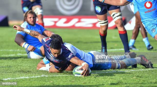 Rebels' Michael Ruru scores a try as he is tackled by Bulls' Lood de Jager during the Super Rugby rugby union match between South Africa's Bulls and...