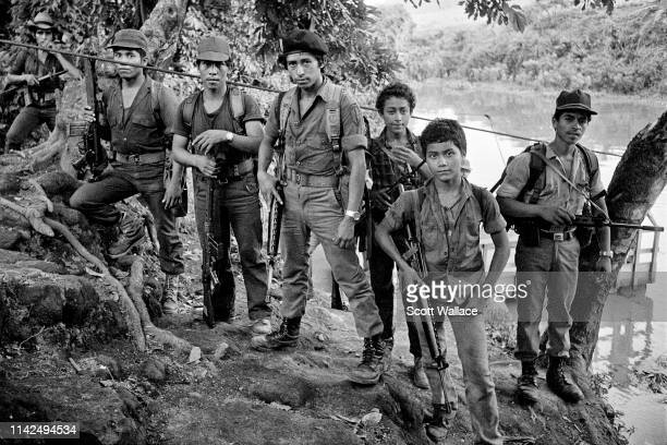 Rebels of the Farabundo Marti National Liberation Front at the point of a ferry crossing, La Anchila, Usulutan, El Salvador 1983.