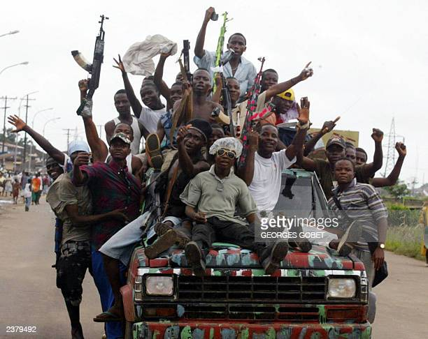 Rebels of the LURD celebrate in the Freeport suburb in Monrovia the arrival of journalists who for the first time crossed the frontline between the...