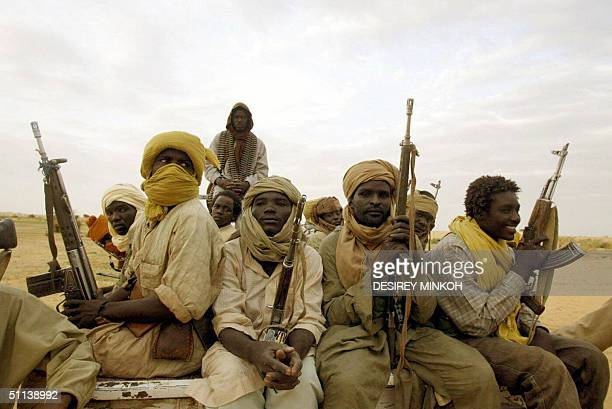 Rebels of the Movement for Justice and Equality fighting Sudanese troops patrol 28 July 2004 in the northern part of the western Sudanese Darfur...