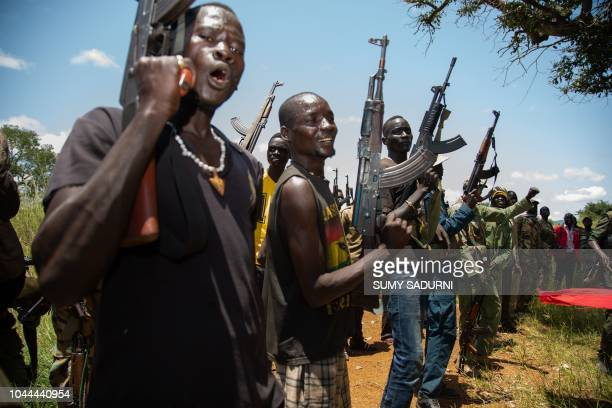 Rebels of the Sudan People's Liberation MovementinOpposition a South Sudanese antigovernment force take part in a military exercise at a base in...