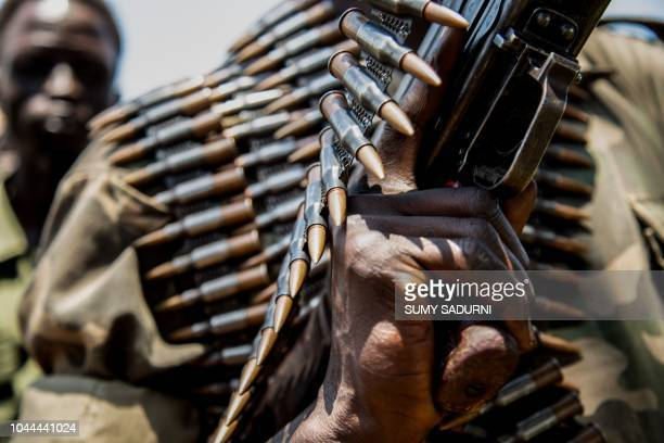 TOPSHOT Rebels of the Sudan People's Liberation MovementinOpposition a South Sudanese antigovernment force hold ammunitions which they say were...