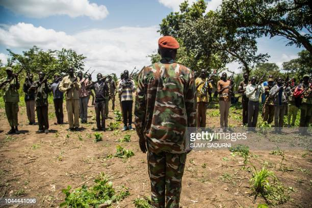Rebels of the Sudan People's Liberation MovementinOpposition a South Sudanese antigovernment force take part in a military exercise at their base in...