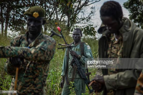 Rebels of the Sudan People's Liberation MovementinOpposition a South Sudanese antigovernment force patrol around their base on September 22 in...