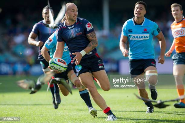 Rebels player Reece Hodge breaks through Waratahs defence at round 5 of the Super Rugby between Waratahs and Rebels at Allianz Stadium in Sydney on...