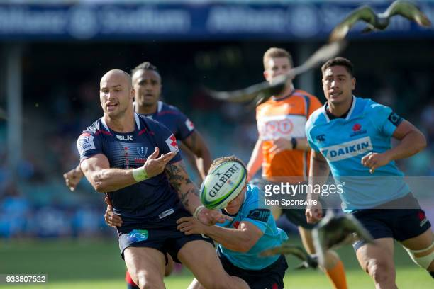 Rebels player Reece Hodge offloads a pass at round 5 of the Super Rugby between Waratahs and Rebels at Allianz Stadium in Sydney on March 18 2018