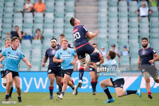 Rebels player Richard Hardwick takes the high ball ahead of Waratahs player Alex Newsome at round 5 of the Super Rugby between Waratahs and Rebels at...