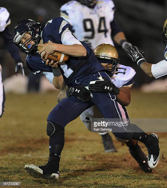 Rebels quarterback Justin Brown kept the ball on a third quarter play Fridya night The Columbine High School football team defeated Mullen 2421 at...