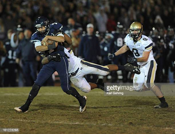 Rebels quarterback Justin Brown picked up 11 yards on a fourthdown play in the third quarter The Columbine High School football team defeated Mullen...