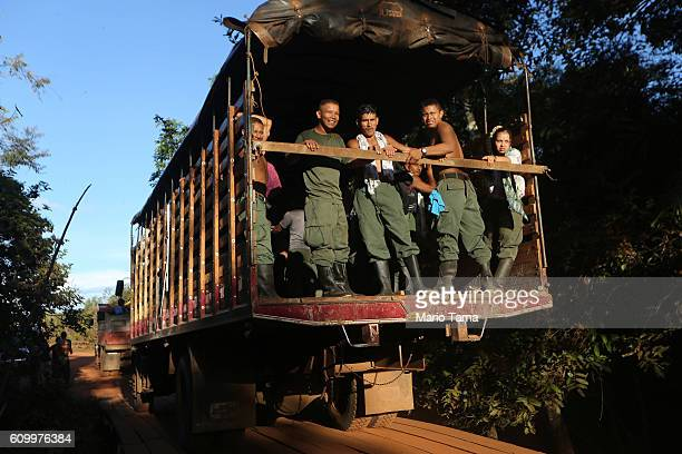 FARC rebels ride on a truck at the 10th Guerrilla Conference in the remote Yari plains where the peace accord was in the process of being ratified by...