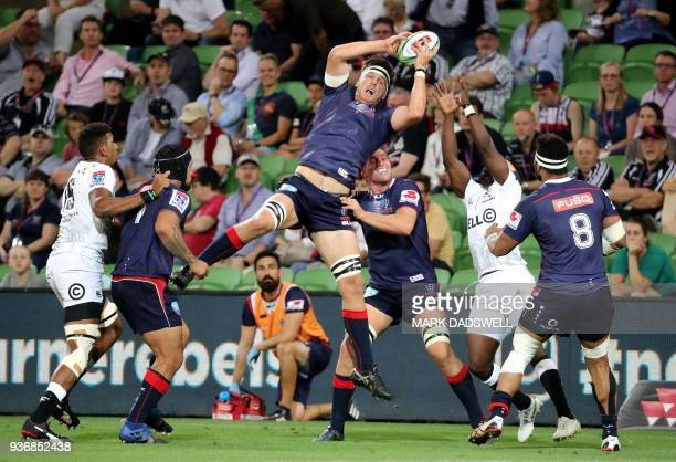 Rebels' Ross HayllettPetty gathers the ball during the Super Rugby union match between the Melbourne Rebels of Australia and the Coastal Sharks of...