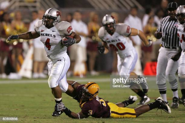 """Rebels running back Frank """"The Tank"""" Summers runs down field during an overtime win against the Arizona State Sun Devils at Sun Devil Stadium in..."""