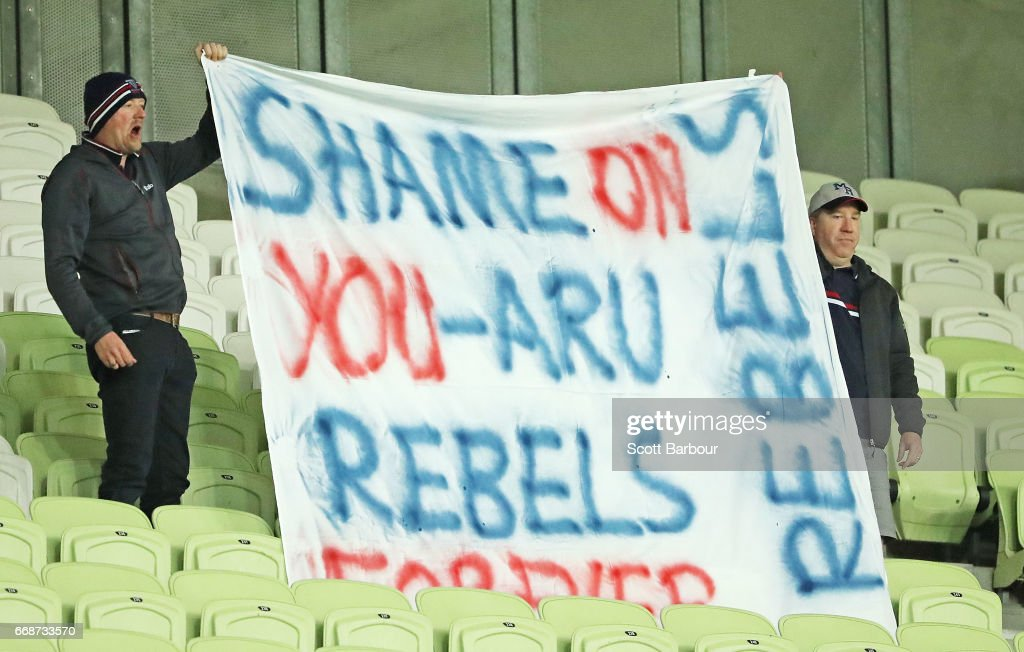 Rebels supporters in the crowd hold a sign aloft which reads 'Shame on you - ARU, Rebels forever' during the round eight Super Rugby match between the Rebels and the Brumbies at AAMI Park on April 15, 2017 in Melbourne, Australia.