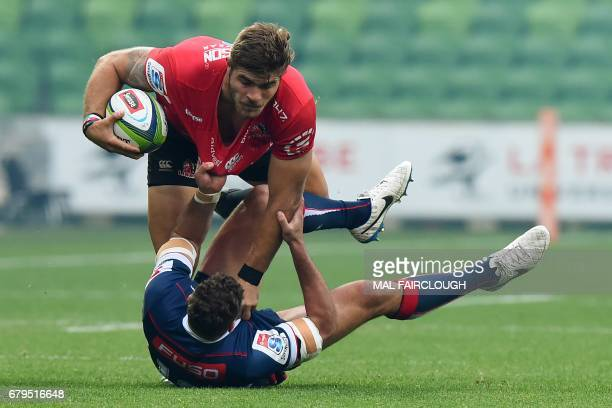 Rebels' Tom English tackles Lions' Malcolm Marx during the Super Rugby match between the Melbourne Rebels and Golden Lions at AAMI Park in Melbourne...