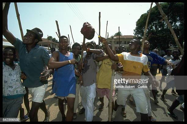 Rebels trying to disrupt the ballot day by attacking the city of Bo have been lynched by the citizens The bodies are cut in pieces and carried as a...