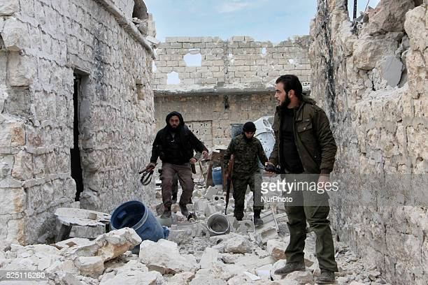 Rebels walk in the front lines of Handarat in Aleppo Syria on December 18 2014