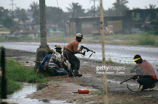 Rebels with the National Patriotic Front of Liberia engage the 72nd Battalion government soldiers faithful to Liberian president Samuel Doe...