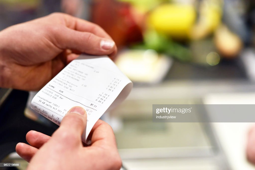 receipt after payment in the supermarket : Stock Photo