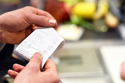 receipt after payment in the supermarket 962219688