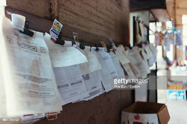 Receipts Hanging By Wall