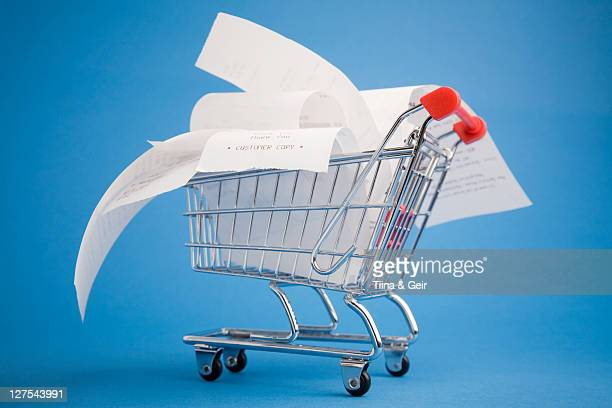 receipts in shopping cart - receipt stock pictures, royalty-free photos & images
