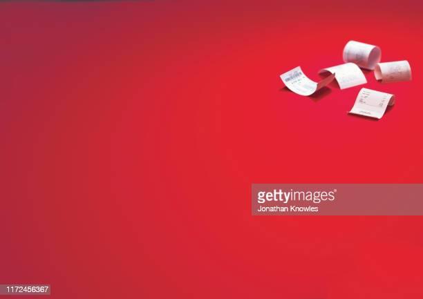 receipts on red background - 領収書 ストックフォトと画像