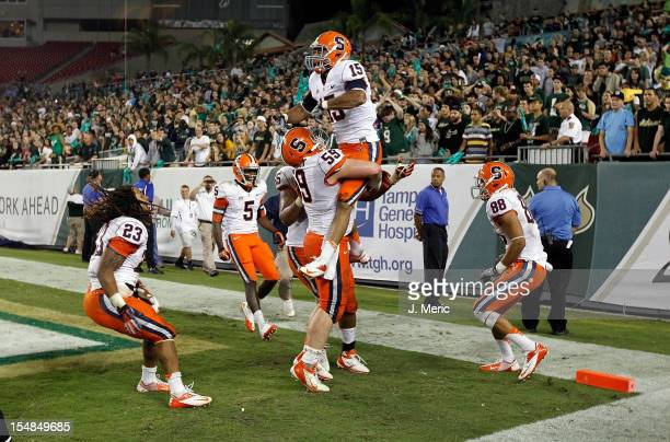 Receiver Alec Lemon of the Syracuse Orange celebrates his game winning touchdown against the South Florida Bulls during the game at Raymond James...