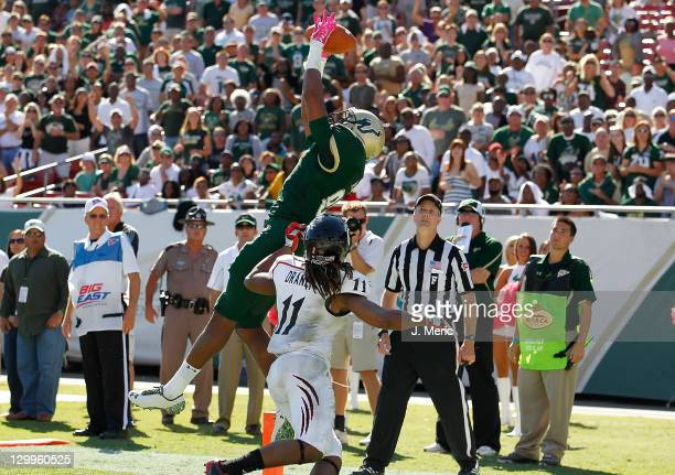 Receiver Andre Davis of the South Florida Bulls catches a touchdown pass over defender Deyen Drane of the Cincinnati Bearcats at during the game at...
