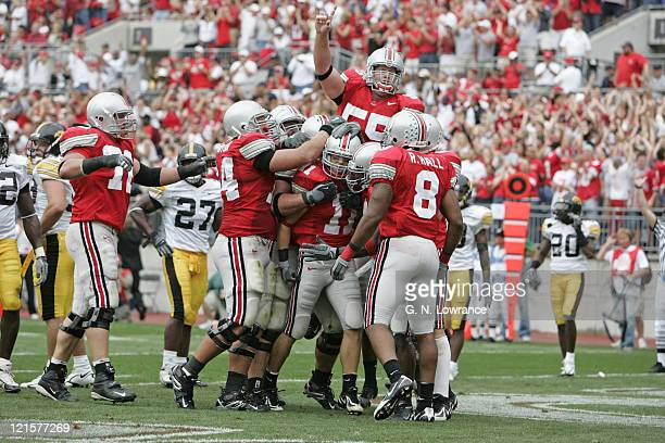 Receiver Anthony Gonzalez of the Ohio State Buckeyes is congratulated after scoring a touchdown against the Iowa Hawkeyes at Ohio Stadium in...