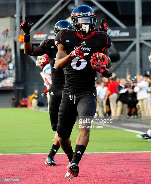 Receiver Anthony McClung of the Cincinnati Bearcats celebrates after scoring a touchdown during a game with the Delaware State Hornets at Nippert...