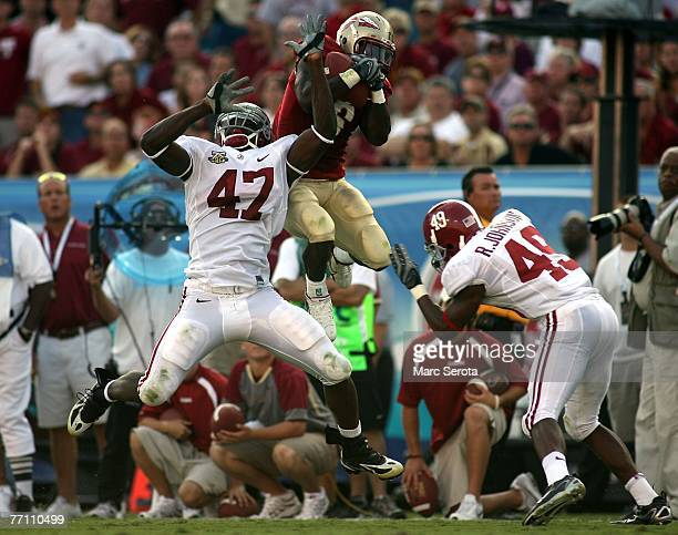 Receiver Antone Smith of the Florida State Seminoles catches a pass in front of defensive back Ezekiel Knight of the University of Alabama September...