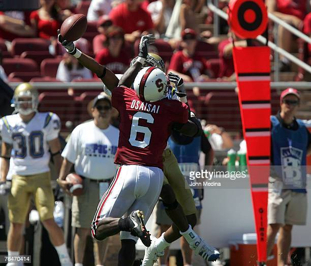 Receiver Brandon Breazell of the UCLA Bruins makes a one-handed catch while being defended by defensive back Wopamo Osaisai of the Stanford Cardinal...
