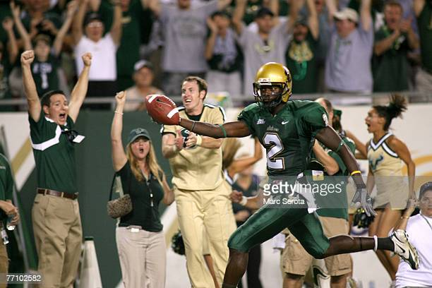 Receiver Carlton Mitchell of the University of South Florida Bulls scores a touchdown against the West Virginia Mountaineers at Raymond James Stadium...